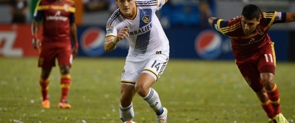LA Galaxy defender Robbie Rogers chases after a ball in his match against RSL