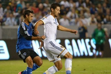 LA Galaxy defender, Omar Gonzalez defends against Chris Wondolowski of the San Jose Earthquakes. Photo by Robert Mora / LA Galaxy
