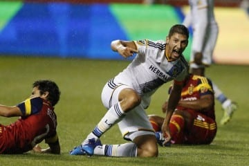 May 6, 2015; Sandy, UT, USA; Los Angeles Galaxy defender Omar Gonzalez (4) reacts after drawing the foul in the penalty box in the final second of their game against the Real Salt Lake defender Tony Beltran (2) and defender Aaron Maund (4) at Rio Tinto Stadium. Mandatory Credit: Jeff Swinger-USA TODAY Sports