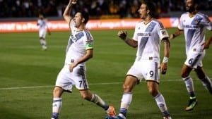 LOS ANGELES, CA - MARCH 06: Robbie Keane #7 of the Los Angeles Galaxy celebrates with Alan Gordon #9 and Baggio Husidic #6 after scoring the Galaxy's second goal in the second half against the Chicago Fire at StubHub Center on March 6, 2015 in Los Angeles, California. The Galaxy won 2-0. (Photo by Stephen Dunn/Getty Images)