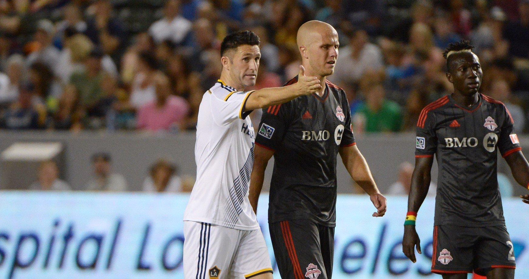 LA Galaxy's Robbie Keane talks to TFC's Michael Bradley